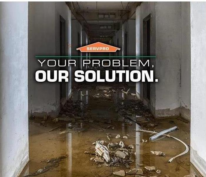 "photo of commercial water damage with SERVPRO logo and text ""Your Problem, Our Solution"""