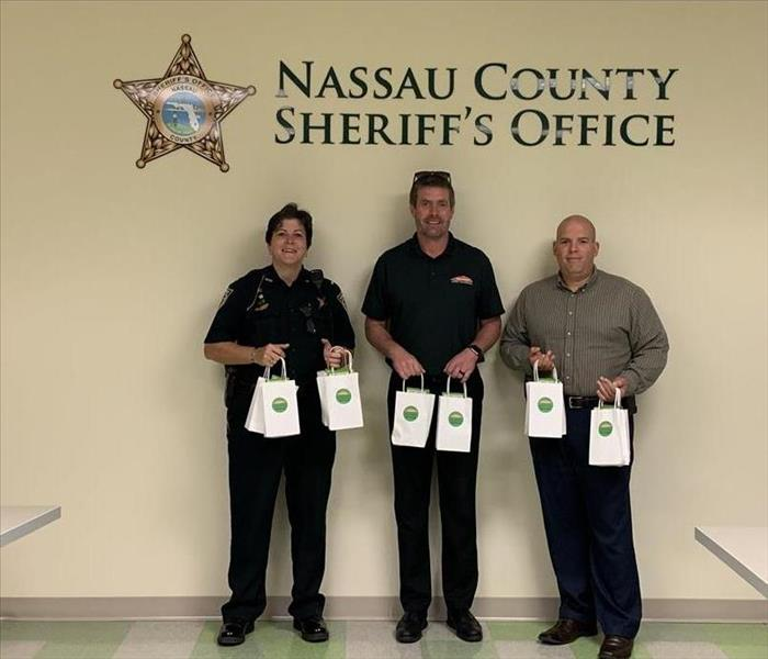 Cory Palmer and two members of Nassau County Sheriff