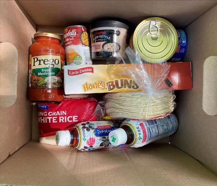 Box containing non-perishable food items donated to Barnabas Food Pantry.